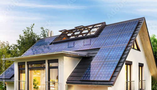 Fotografia  Solar panels on the gable roof of a modern house