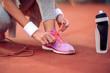 Runner tying jogging shoes