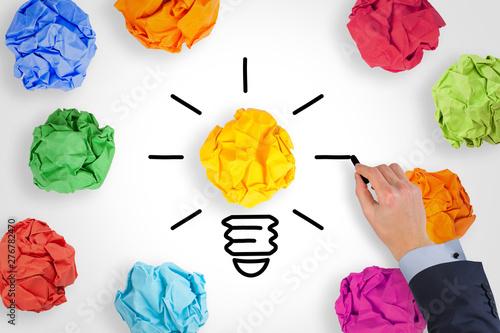 Fototapeta New Idea Concepts Light Bulb with Crumpled Paper on White Background obraz na płótnie