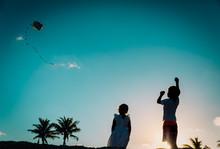 Kids- Boy And Girl- Flying A K...