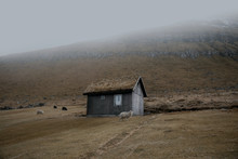 Old Wooden Cabin In A Foggy Landscape