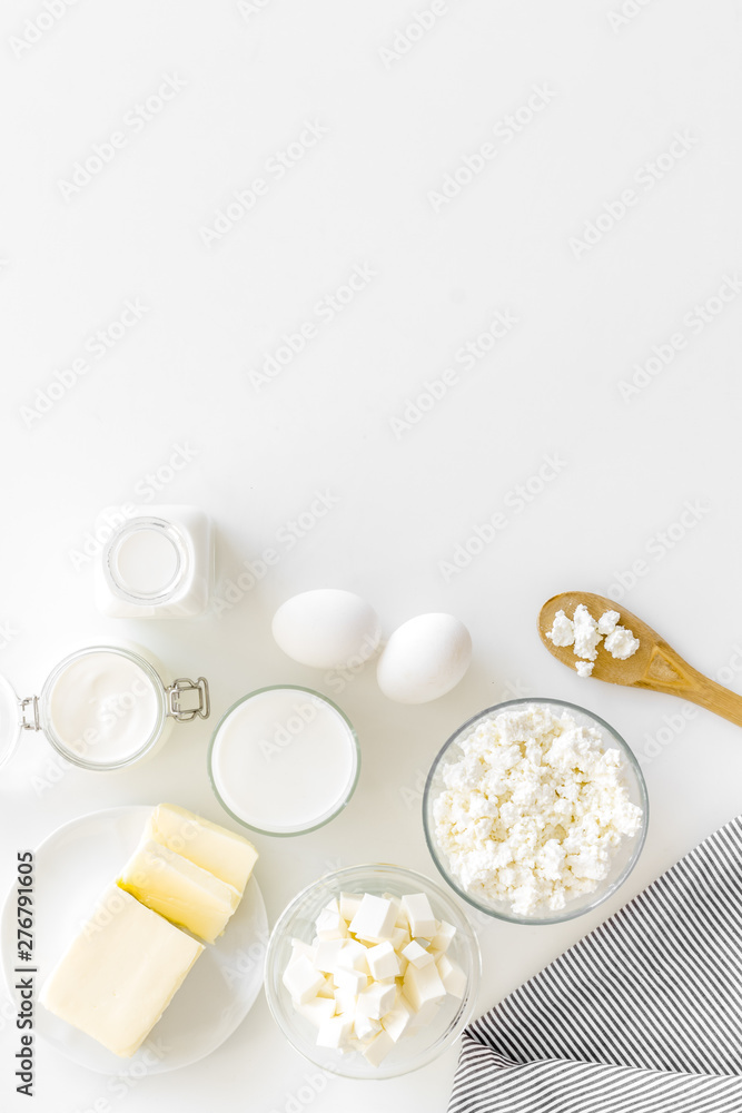Fototapety, obrazy: Fresh dairy products for breakfast with milk, cottage, eggs, butter, yougurt on white background top view mock up