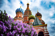 Leinwanddruck Bild - Spring in Moscow Red Square. A vibrant purple lilac tree blossom and a famous Saint Basil's Cathedral with blue cloudy sky at the backround.