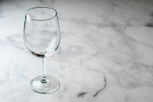 Empty Wine Glass On Marble Table Top.