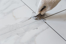 Grouting Tiles Seams With A Ru...