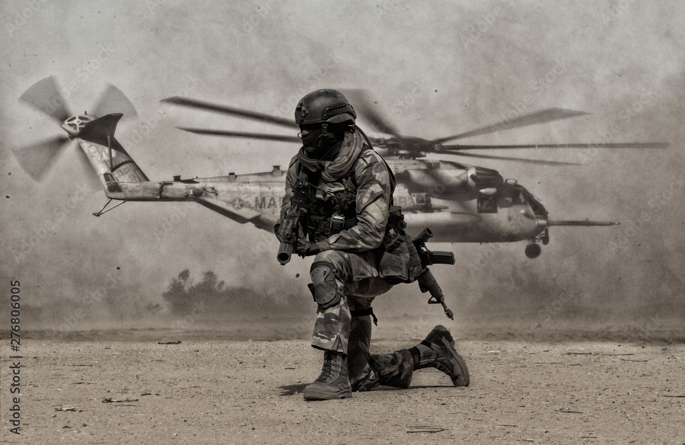 Fototapety, obrazy: Military soldier between dust in front of helicopter in battle field
