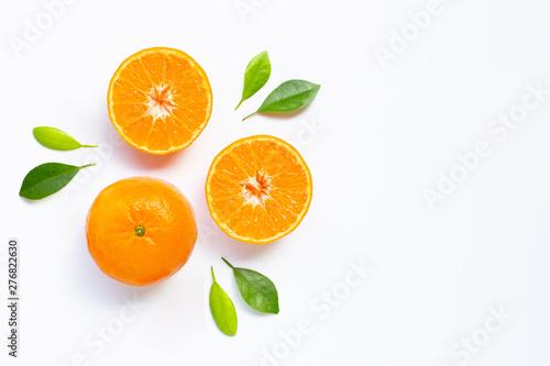 Fresh orange citrus fruit with leaves on white background.