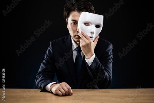 Fotografía 仮面をつけたビジネスマン