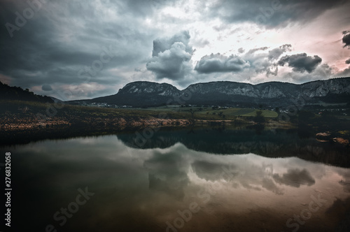 Aluminium Prints Mountains reflected on the lake. cloudy sky in lower Austria