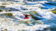 Kayaker Navigating Through The White Waters Of The Thompson River As The River Winds  Through The Fraser Canyon In British Columbia, Canada