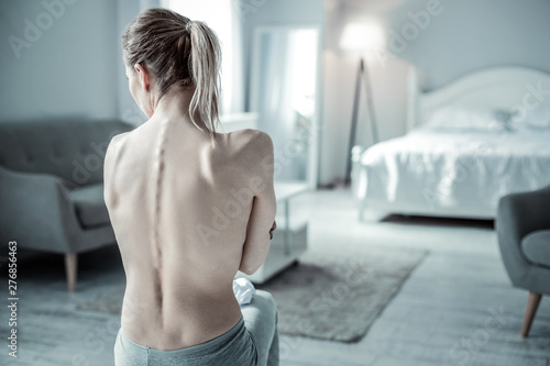 Back view of slim girl that sitting on the foreground Canvas Print