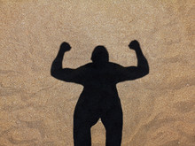 Shadow Of Muscle Man On The Beach, Silhouette Of Strong Man In The Sand