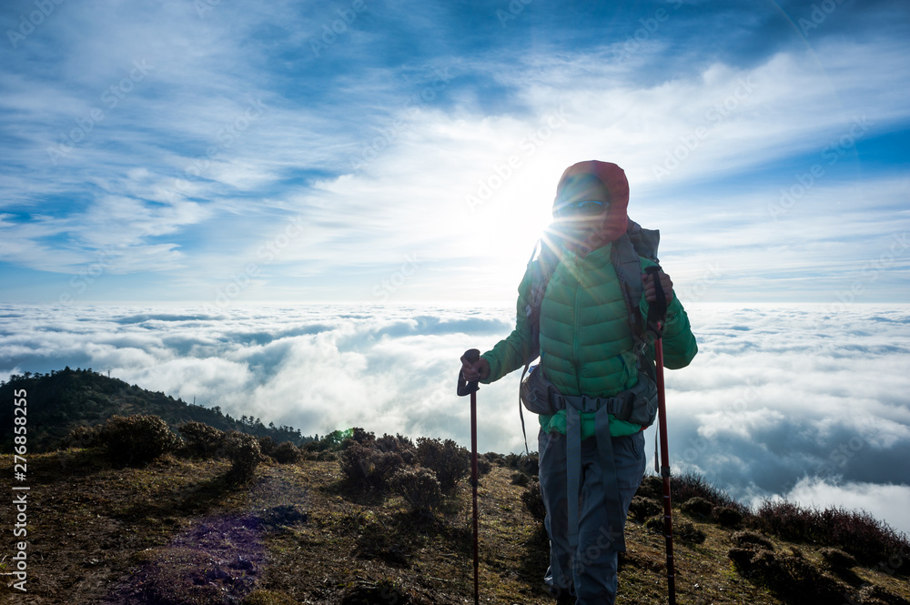 Fototapety, obrazy: Successful young woman backpacker at sunrise mountain peak