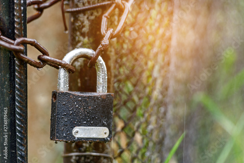 Padlock on the chain - the concept of protection Poster Mural XXL