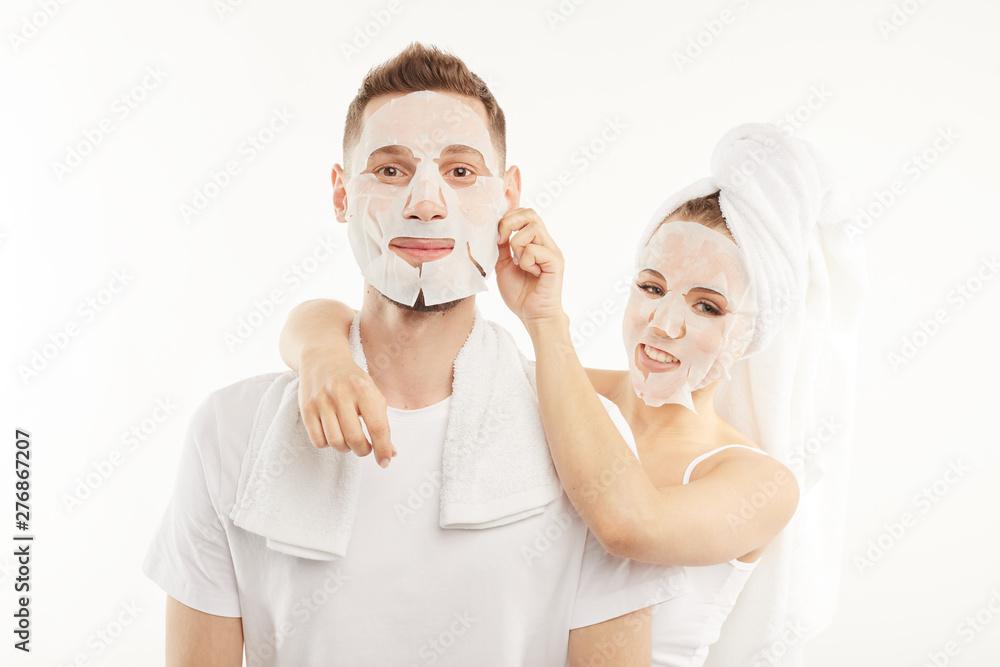 Fototapety, obrazy: Man and woman use hygienic face masks.