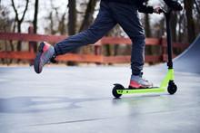 Kid Riding On Stunt Scooter On The Skatepark Ramp