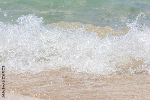 Macro shot of some sea waves hitting the beach