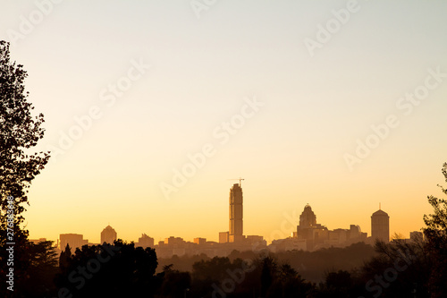 Sunrise over Sandton skyline in Johannesburg, South Africa, Africa. Silhouette of Sandton buildings. Sandton and Nelson Mandela square are popular tourist destinations.