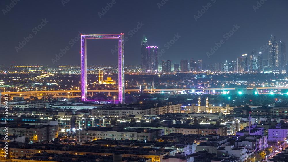 Fototapeta Dubai Frame with Zabeel Masjid mosque illuminated at night timelapse.