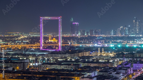 Fototapeta Dubai Frame with Zabeel Masjid mosque illuminated at night timelapse. obraz