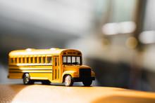 Miniature Yellow School Bus With Sunlight