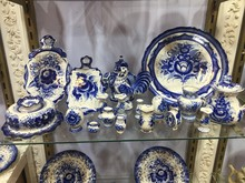 Blue Porcelain Crockery For Sale. Selection Of Plates, Bowls And Porcelain For Sale In The Shop. Blue Porcelain Utensils With Plates And Cups And Bowls On Display At Street Market.