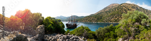 Fotomural Pirate ship moored in a secluded bay with turquoise water at sunset, Oludeniz, T