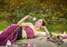 Woman Harvesting Water Lilies