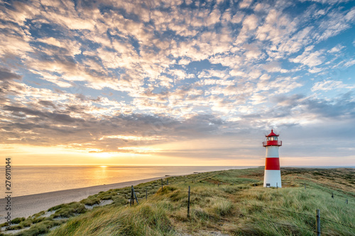 Spoed Foto op Canvas Bleke violet Red Lighthouse on the island of Sylt in North Frisia, Schleswig-Holstein, Germany