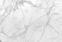 Smooth Flat Marble Rock Surface Patterned  With White And Streaks Of Gray