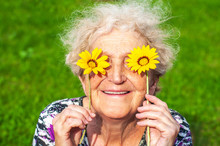 A Cheerful Grandmother Looks A...