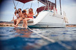 canvas print picture - Happy people relaxing on the yacht deck.