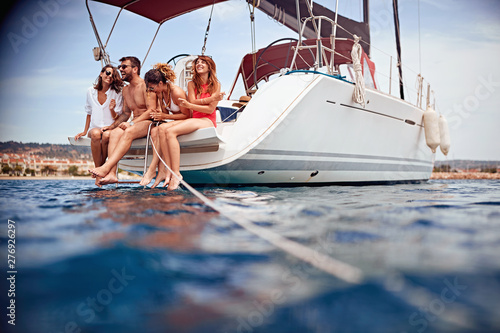 Happy people relaxing on the yacht deck.