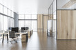 Gray and wooden open space office with hall