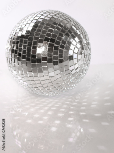 mirror ball.isolated on a dark background. photo with copy space - 276929213