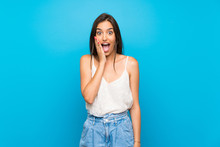 Young Woman Over Isolated Blue Background With Surprise And Shocked Facial Expression