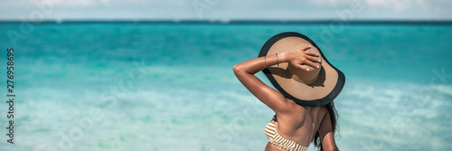 Fototapeta Beach suntan vacation woman relaxing wearing sun fashion floppy hat on ocean background panoramic banner. obraz