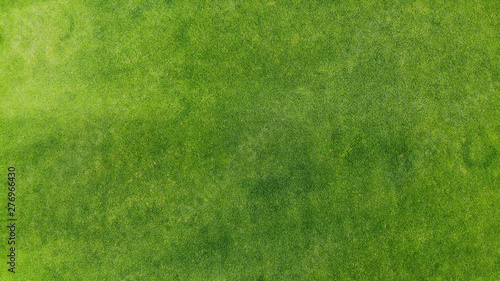 Tuinposter Gras Aerial. Green grass texture background. Top view from drone.