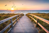Fototapeta Bridge - Beautiful beach with dunes at sunset, Germany