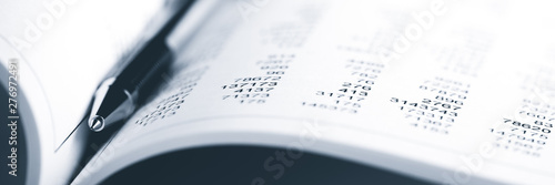 Photo Close-up Of Open Accounting Book With Pen - Business Accounting  Concept