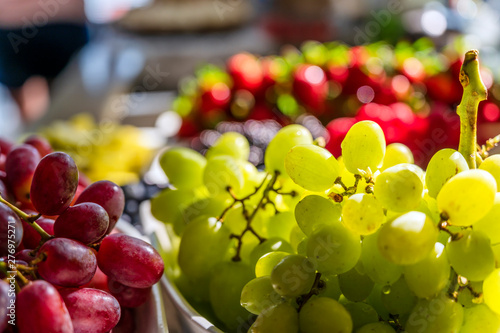 Fotografiet  Nutritious natural organic clusters of grapes laid out on the dessert table