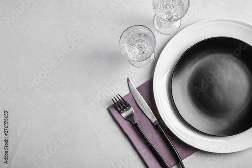 Stylish elegant table setting on stone surface, top view. Space for text