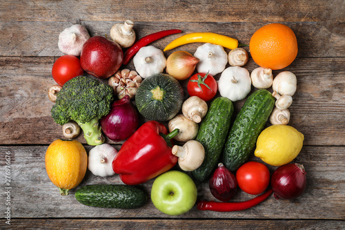 Ripe fruits and vegetables on wooden table, flat lay © New Africa