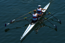 Two Male Rowers In A Double Racing Boat With Synchronous Oar Stroke