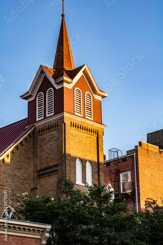 A steeple on a church in the late afternoon sun