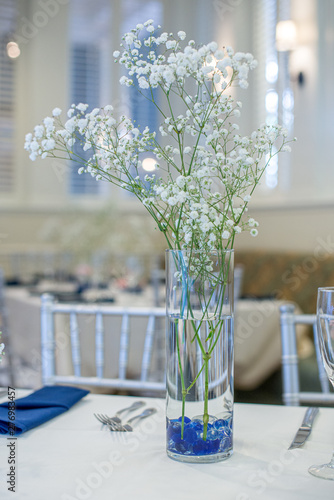 Babys breath flowers in glass vase centerpiece