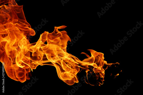 Fotobehang Vuur movement of fire flames isolated on black background.