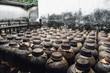 Leinwanddruck Bild - Jars use for fermented white liquor or Rice whisky in factory in China