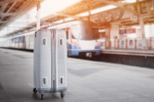 Sillver Suitcases Or Baggage At Blurred Of Sky Train Station Platform. Trip Vacation Or Holiday Tourism By Bts City Rail In Bangkok Thailand.