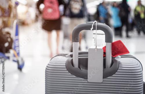 Fototapeta Luggage holder tag blank label on suitcase / baggage put letter Travel insuranc